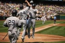 Oakland A's vs New York Yankees #45 1B Luke Voit Celebrates with teammate #24 Gary Sanchez after home run. Photos by Tod Fierner ( Martinez News-Gazette )