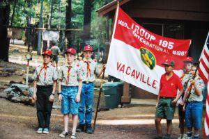 Ed Roubal holding the troop flag in 1992.