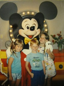 Vivian's three children with Mickey Mouse in 1988