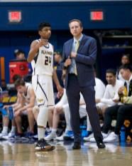 Coach Petiti strategizes with Lorenzo Fonseca. Photos by Mark Fierner (Martinez News-Gazette)