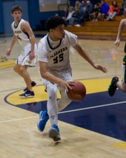Iverson Suisala dribbles toward the paint. Photos by Mark Fierner (Martinez News-Gazette)