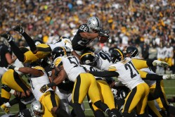 Oakland Raiders vs Pittsburgh Steelers RB #28 Doug Martin Over the top Photos by Tod Fierner ( Martinez News-Gazette )