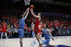 Saint Mary's Gaels vs San Diego Toreros #00 Tanner Krebs drives to the hoop for two Photos by Tod Fierner (MTZ Gazette)