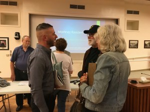 Brandon Varise (left foreground) speaks with two Martinez residents.