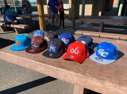Collection of Pecos League hats.