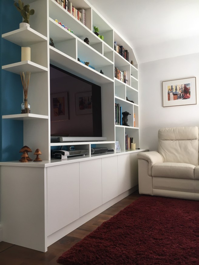 Living room shelving with integrated TV area