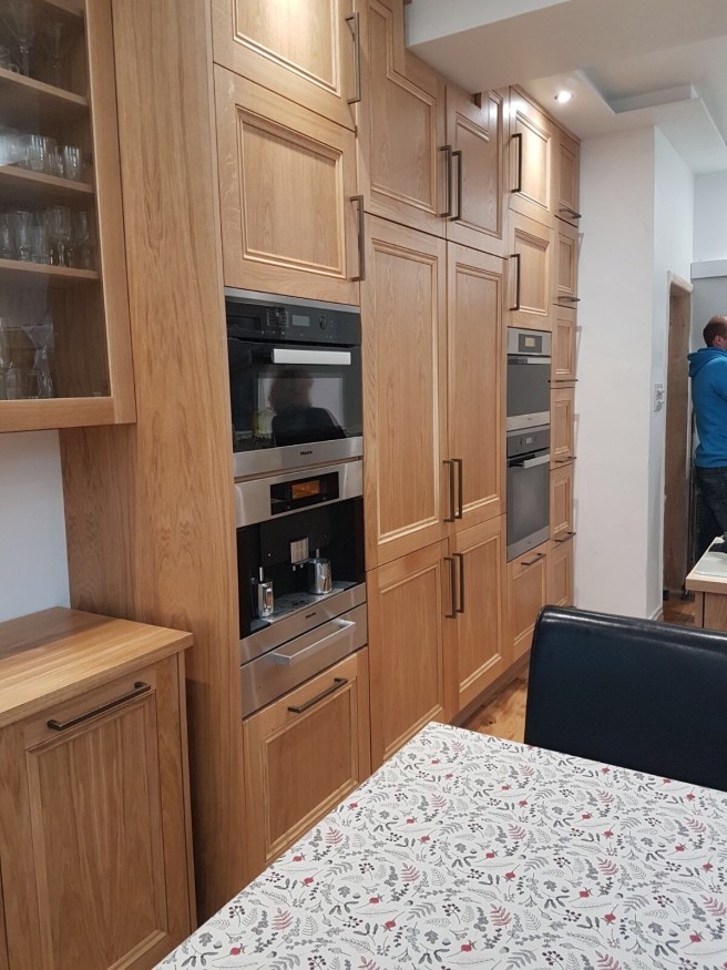 Oak kitchen cabinets for oven and fridge housing