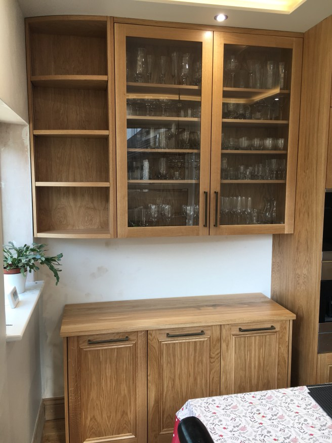 Glazed kitchen cupboard with glasses on shelves