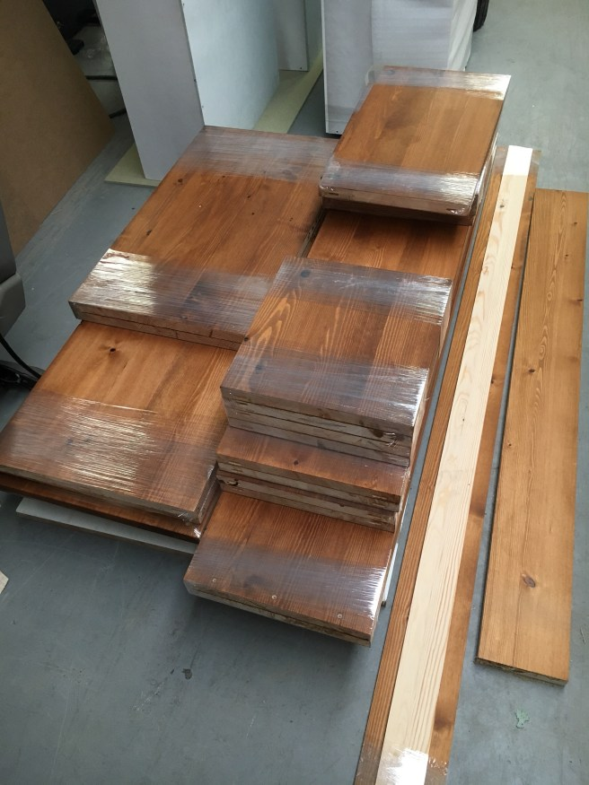 Solid pine wooden panels staining with dark oak