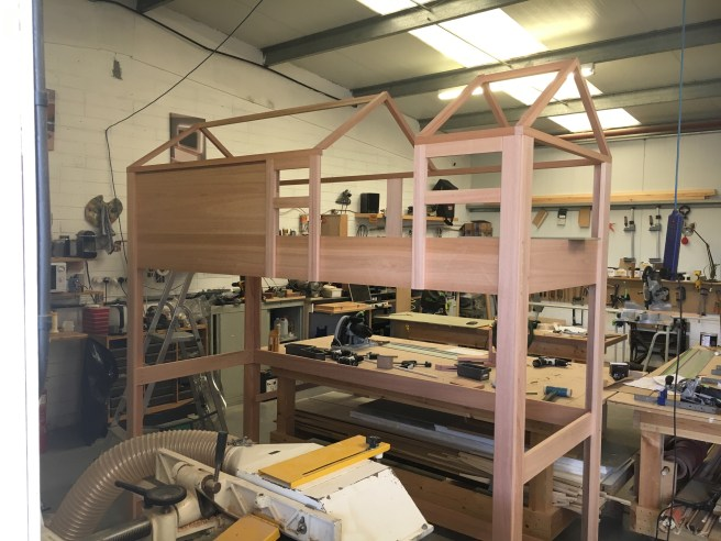 Bunk bed with roof made from red grandis