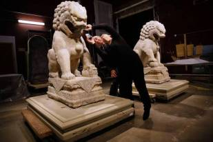 Field Museum President and CEO Richard Lariviere, left, and Exhibitions Conservator Shelley Paine examine Tuesday, Aug. 26, 2014 one of two stone lions from 13th century China that will be part of Cyrus Tang Hall of Chine, a upcoming, permanent exhibit announced today at the museum. (Chris Walker/Chicago Tribune) B583963750Z.1 -ent-0827-field-china ....OUTSIDE TRIBUNE CO.- NO MAGS, NO SALES, NO INTERNET, NO TV, CHICAGO OUT, NO DIGITAL MANIPULATION...