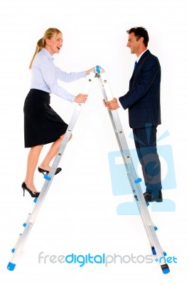 business-people-climbing-on-ladder-10063675