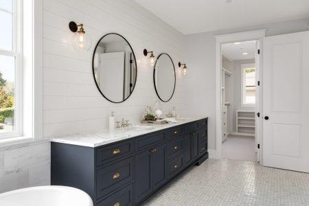 navy vanity and shiplap bathroom