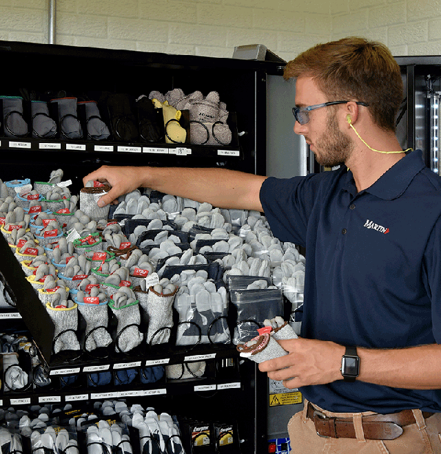 employee stocking industrial vending machine
