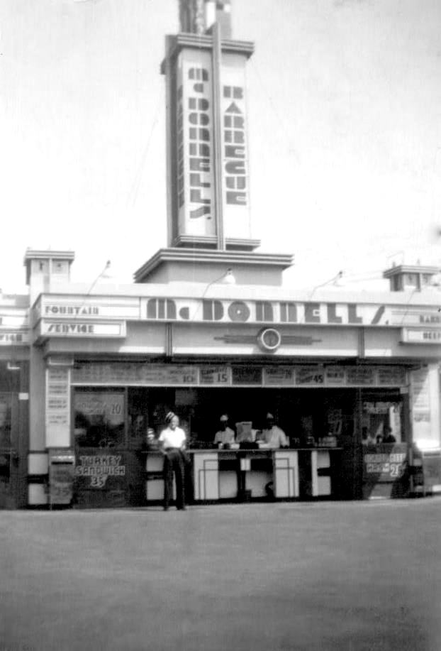 McDonnell's No. 3 NE corner, Wilshire & Robertson, carhop standing outside circa 1938.(Wetzel family collection)