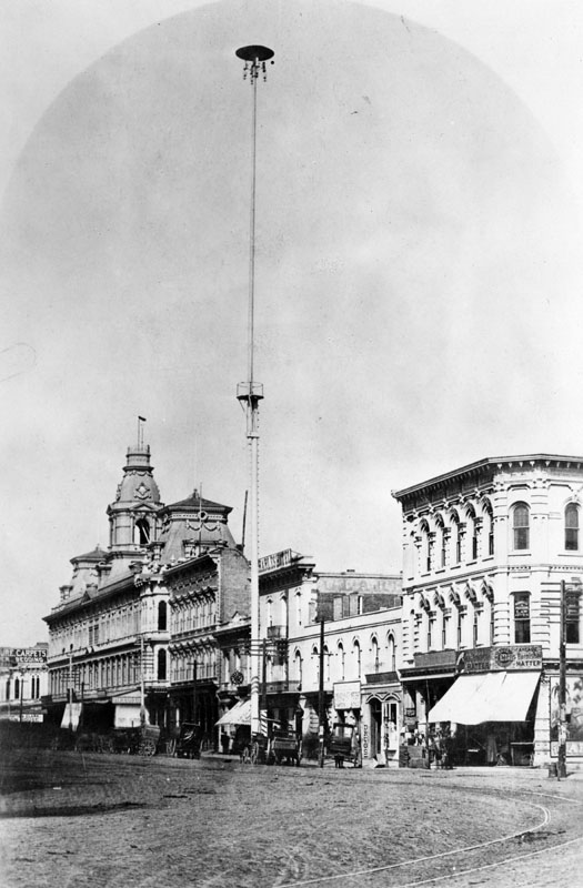 A 150-foot electric street light at Main and Commercial Streets, downtown Los Angeles, circa 1882