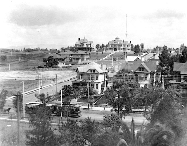 Residential stretch of Orange Street (later Wilshire Boulevard) at Lucas Avenue, Los Angeles, circa 1892