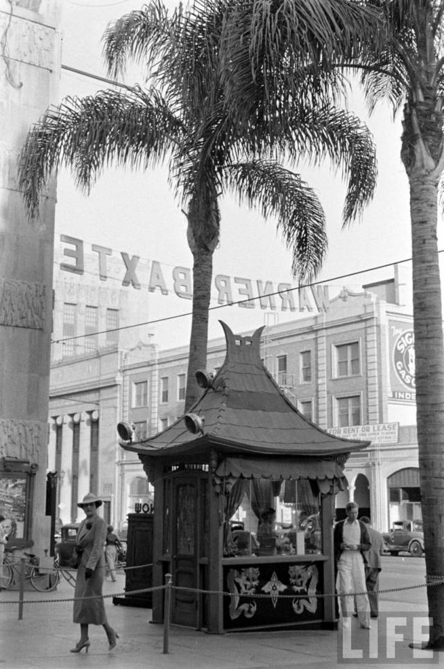 """Grind"" ticket booth in Grauman's Chinese theater courtyard, Hollywood Boulevard, during ""Robin Hood of El Dorado,"" May 1936"