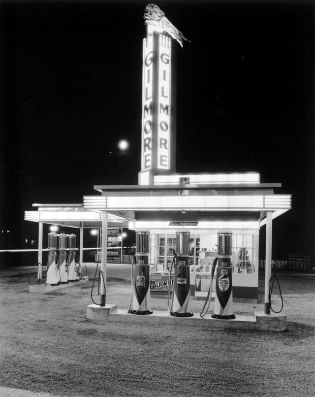 Gilmore gas station lit up at night, Los Angeles, circa 1940