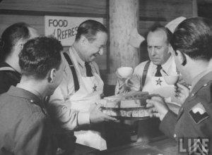 Garden of Allah regulars, Robert Benchley and Charlie Butterworth entertain servicemen at the Hollywood Canteen