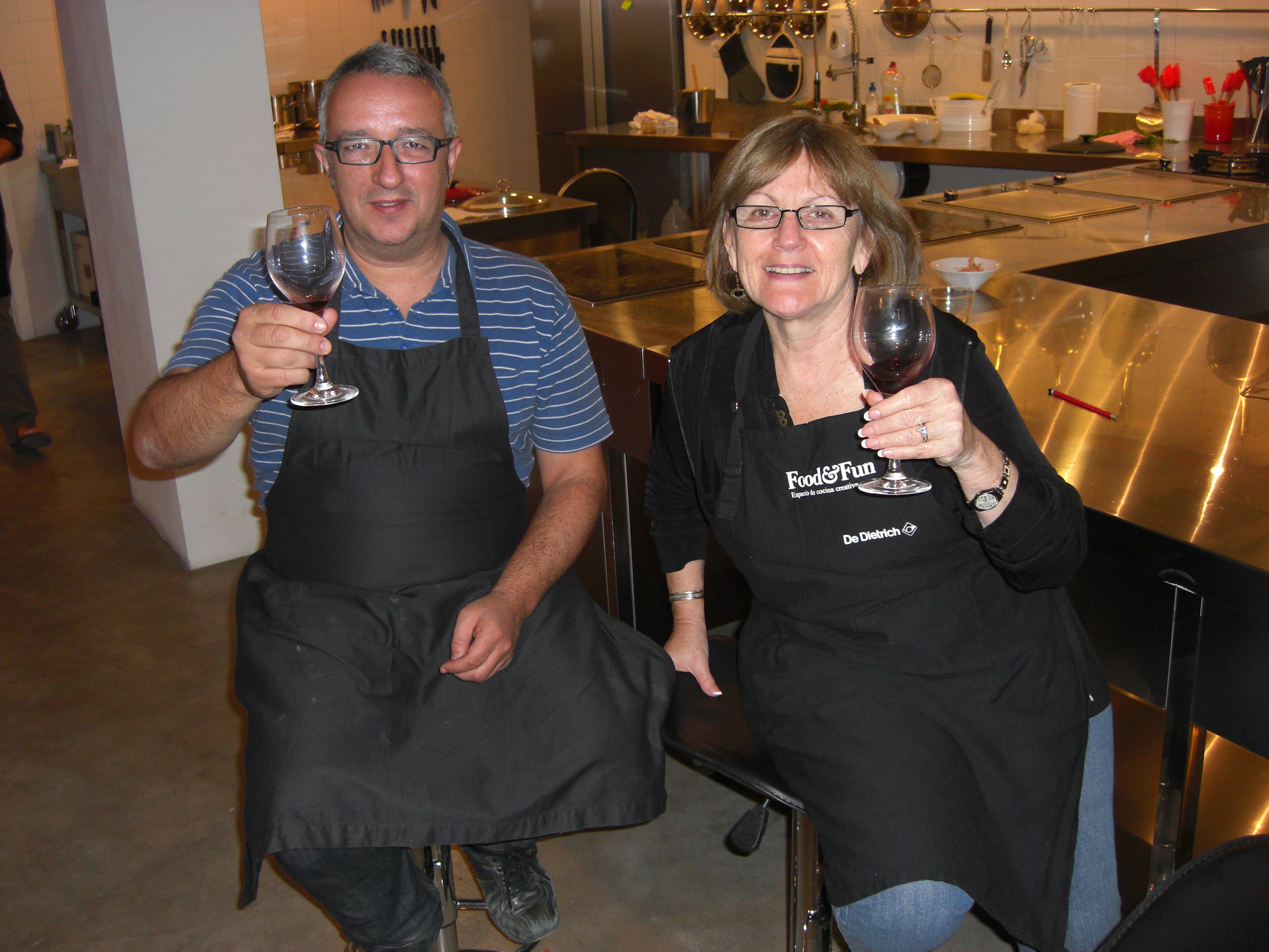 Susan and Pepe hoisting a glass of El Miracle red