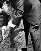 L43335 Boy & man with golf club