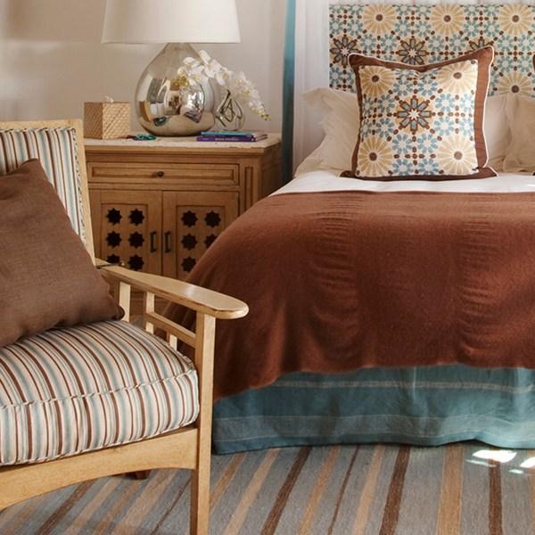 Turkish Ticking brown blue indoor fabric in Malibu living room. Fabric by Martyn Lawrence Bullard