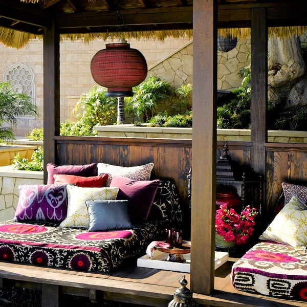 Mamounia Petite Paprika red rust outdoor fabric on cabana daybed pillows, designed by Martyn Lawrence Bullard