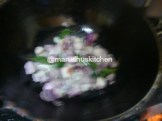 ADD SMALL ONIONS AND CURRY LEAVES