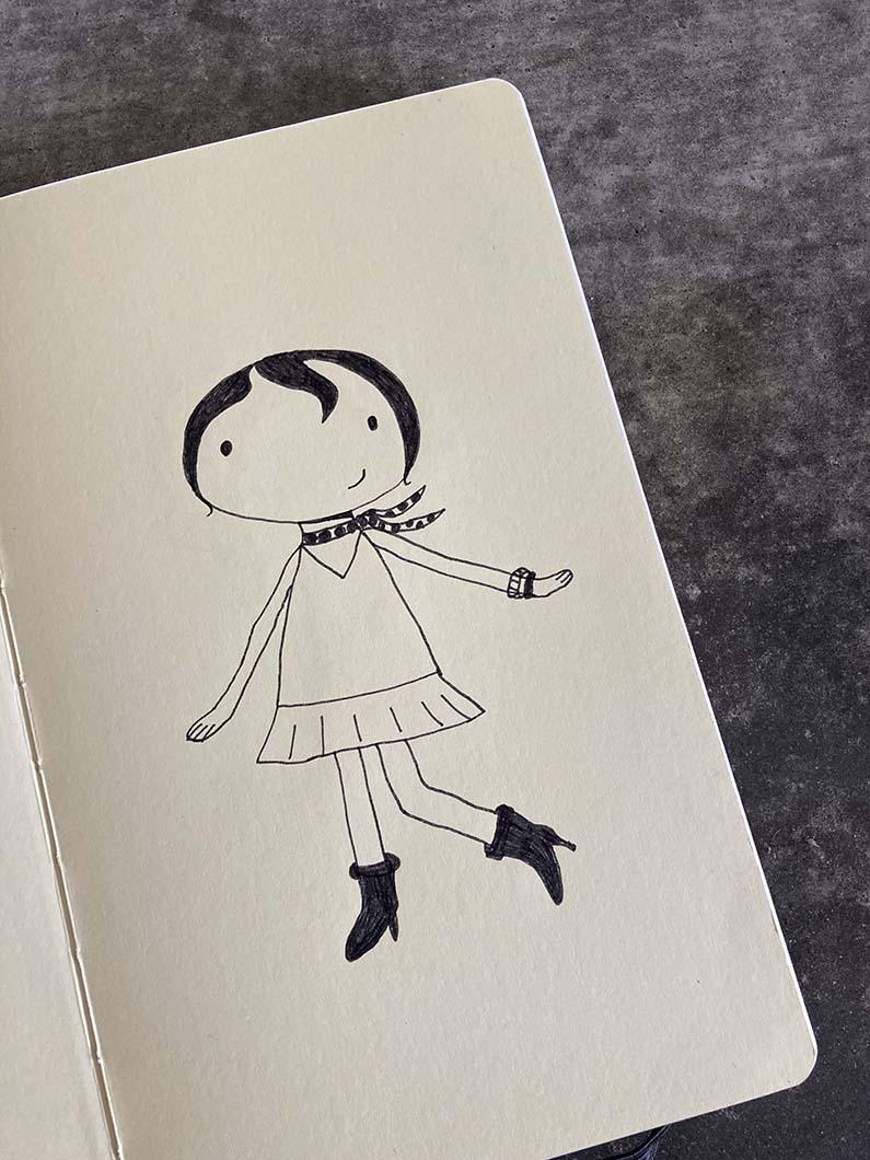 schetsboek met een meisje erin