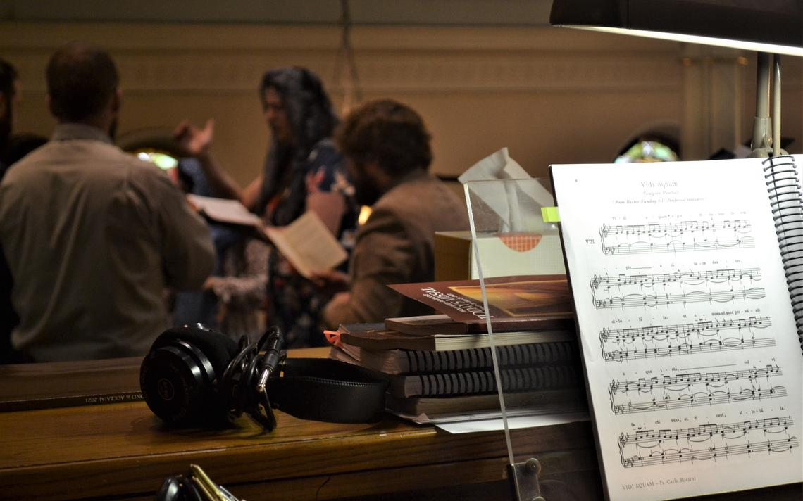 """While the Schola Cantorum sings during a Latin Mass at St. Mary's Cathedral on Sunday, April 18, 2021, the score from the Gregorian chant can be seen, bearing the title """"Vidi áquam."""" Roxane B. Salonen / The Forum"""