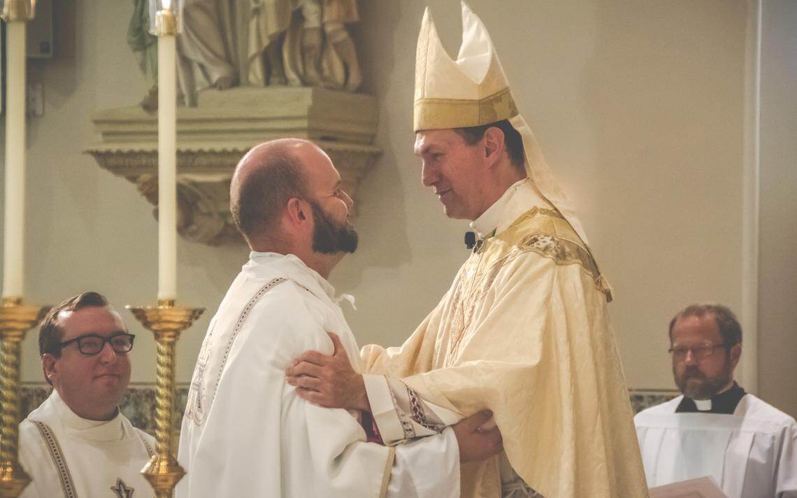 Bishop John Folda (right) embraces new priest Fr. Eric Seitz during his ordination on Aug. 8, 2020, at the Cathedral of St. Mary's in Fargo. Photo by Rebecca Raber / Special to The Forum
