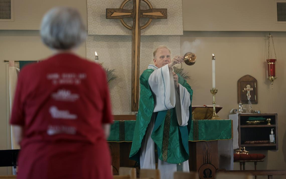Father Jamie Parsley swings a thurible with incense while offering prayers before communion during Wednesday evening mass at St. Stephen's Episcopal Church in north Fargo. David Samson / The Forum