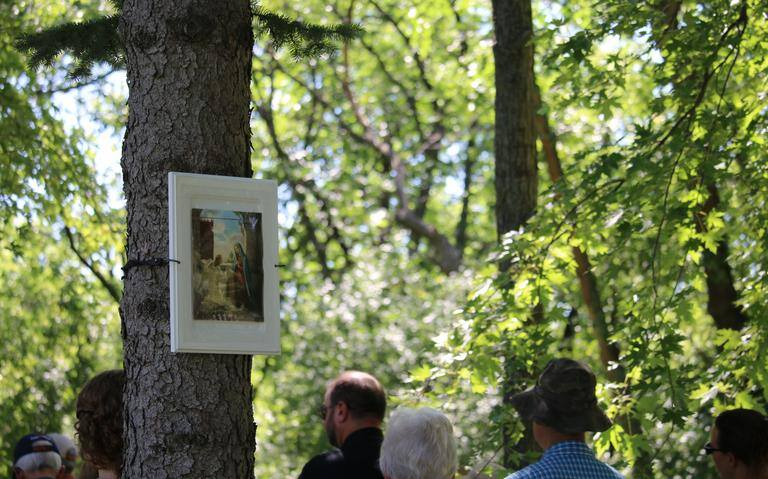 During the Rosary recitation at the annual pilgrimage to Our Lady of the Prairies, seen here on Aug. 16, 2020, the mysteries of the Rosary are shown in pictures hanging from various trees around the woods of Carmel of Mary Monastery. Photo courtesy of Kristina Lahr / New Earth / Special to The Forum