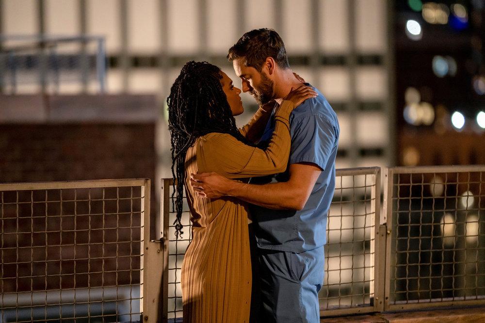 "NEW AMSTERDAM season 4 -- ""More Joy"" Episode 401 -- Pictured: (l-r) Freema Agyeman as Dr. Helen Sharpe, Ryan Eggold as Dr. Max Goodwin -- (Photo by: Zach Dilgard/NBC)"