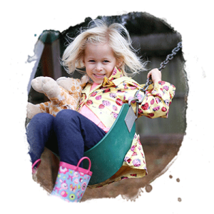 kindergarten girl swings on playground