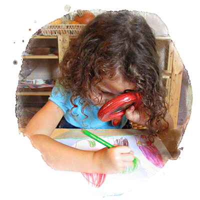 preschool child drawing with magnifying glass