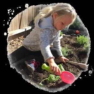 child gardening at school