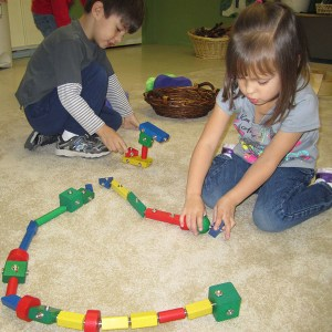 girl building with snap blocks at Marvelously Made School