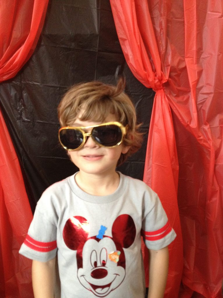 Boy in sunglasses and Mickey Mouse shirt