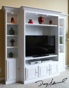 custom cabinetry_white TV cabinet with lighting | Custom woodworker