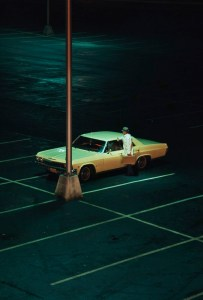 Parking lot at night - lone car