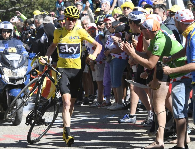 Chris Froome dragging his broken bike up Mont Ventoux, Stage 12.