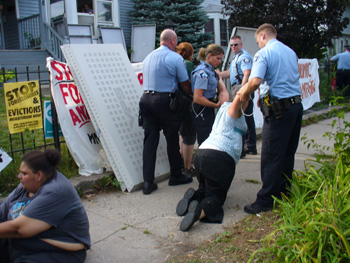 Protester from the MN Coalition for a People's Bailout is arrested trying to stop the eviction of Rosemary Williams.