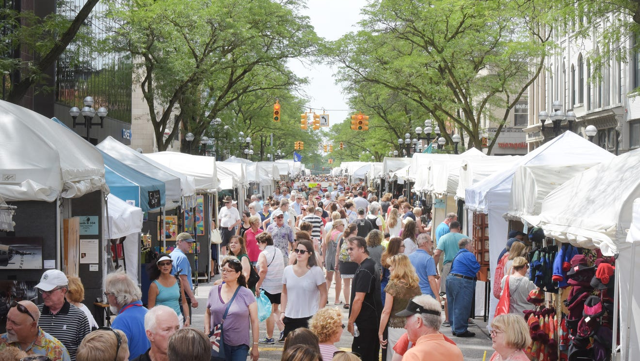 Crowds fill the closed off streets for the annual Ann Arbor Art Fair on Thursday.