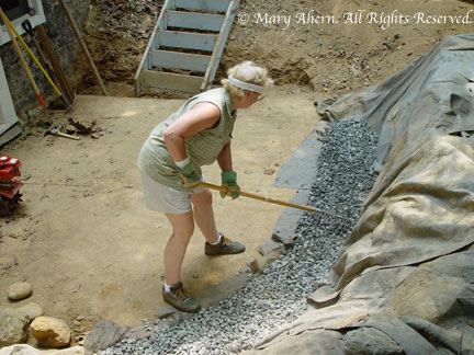 July 9, 2002 Spreading gravel is much harder then raking a lawn.
