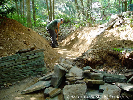 The size of the dry stream bed was reduced and brought more in line with the scale of the surrounding garden