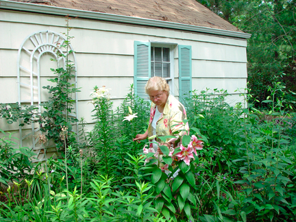Mary Ahern working in her perennial garden.