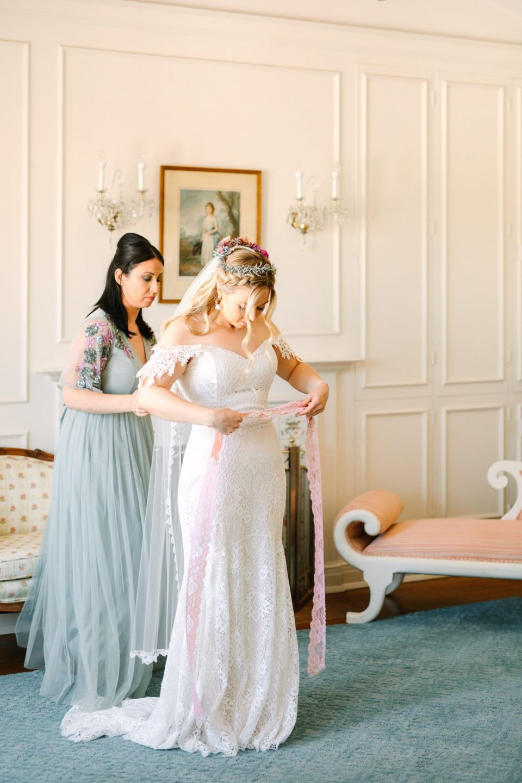 Bride getting dressed at Darlington House - www.marycostaweddings.com