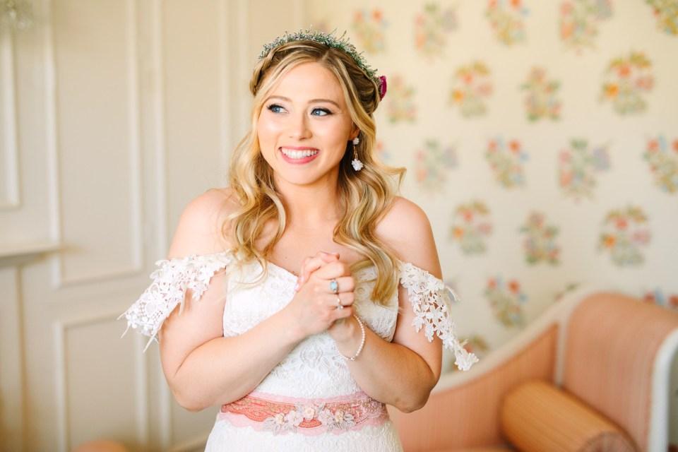 Bride in floral crown smiling - www.marycostaweddings.com